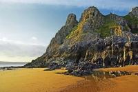 The rugged eastern headland at Three Cliffs Bay